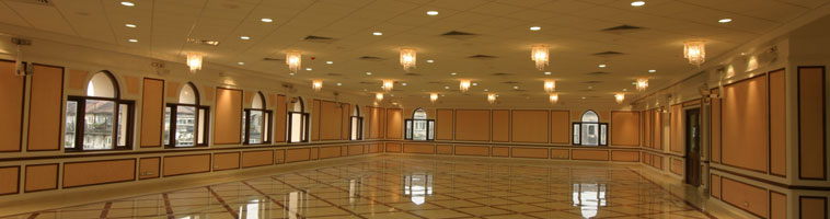 A fully lit hall at Najam Baug